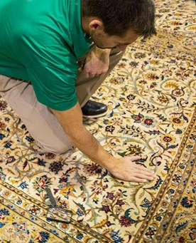 Chem-Dry technician checking area rug before cleaning